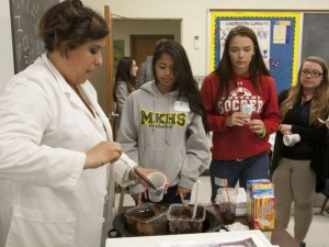 Georgian Court University sponsors teentech, a program that connects girls with science and technology. Samantha Aries (left), a technologist at International Flavors and Fragrances in Hazlet, teaches students about the chemistry of chocolate - May 29, 2014-Lakewood, NJ. (Photo: Staff photographer/Bob Bielk/Asbury Park Press )